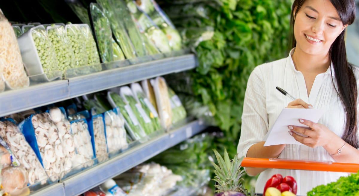 Women shopping for keto groceries using keto food list pdf